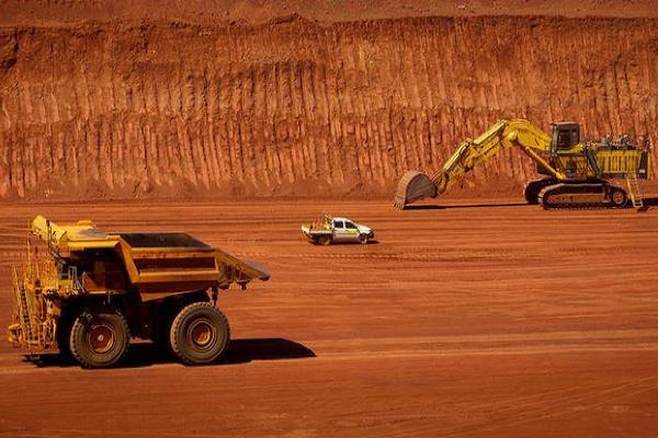 Rio Tinto digging up more iron ore despite slumping prices
