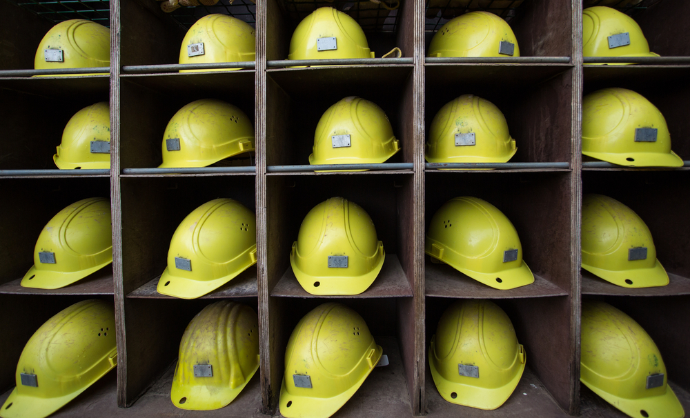 Miners yellow helmets on shelving unit, unemployed, mining setback,  mine, mining, worker, site, employed, slow industry, protective -Colleen - 1000