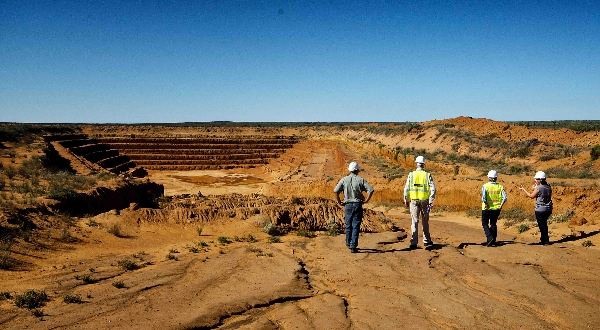 SRK Staff members inspect a test pit in the Western Cape