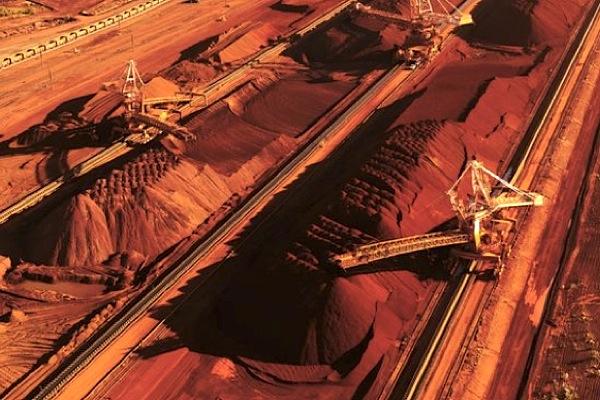 BHP Billiton beats iron ore guidance, takes copper write-downs