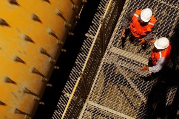 Glencore hit by $790 million writedown, cuts spending