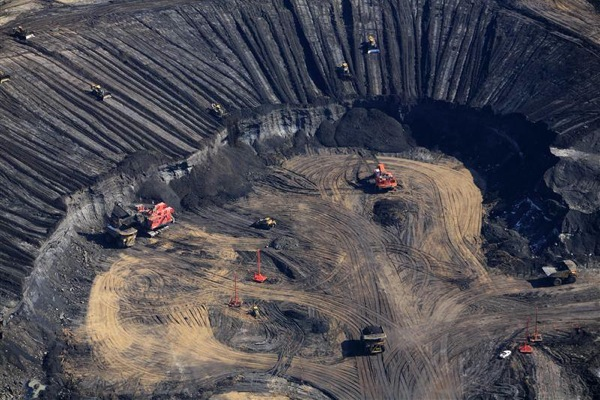 Price of crude from Canada's oil sands more than halves since June