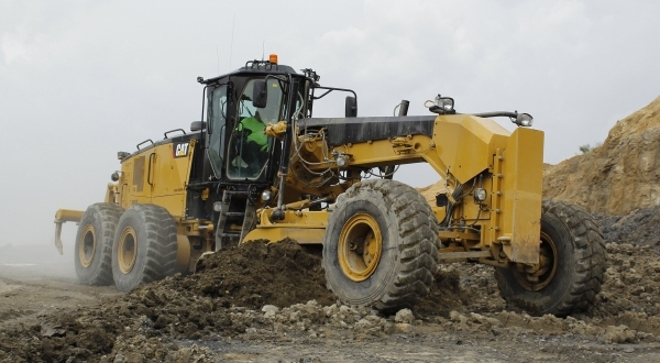 Cat 18M3 Motor Grader clears access road