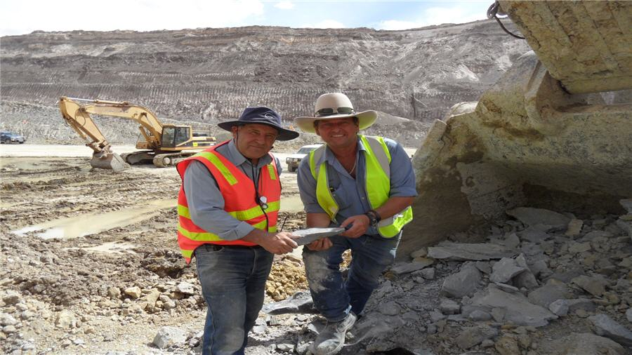 Steve Radford, principal of CMC and Chris Giles, Managing Director of Havilah, pause to congratulate each other on the joint achievement of mining the first high grade ore (grey clay) from the Portia open pit, some 75 metres below the surface.