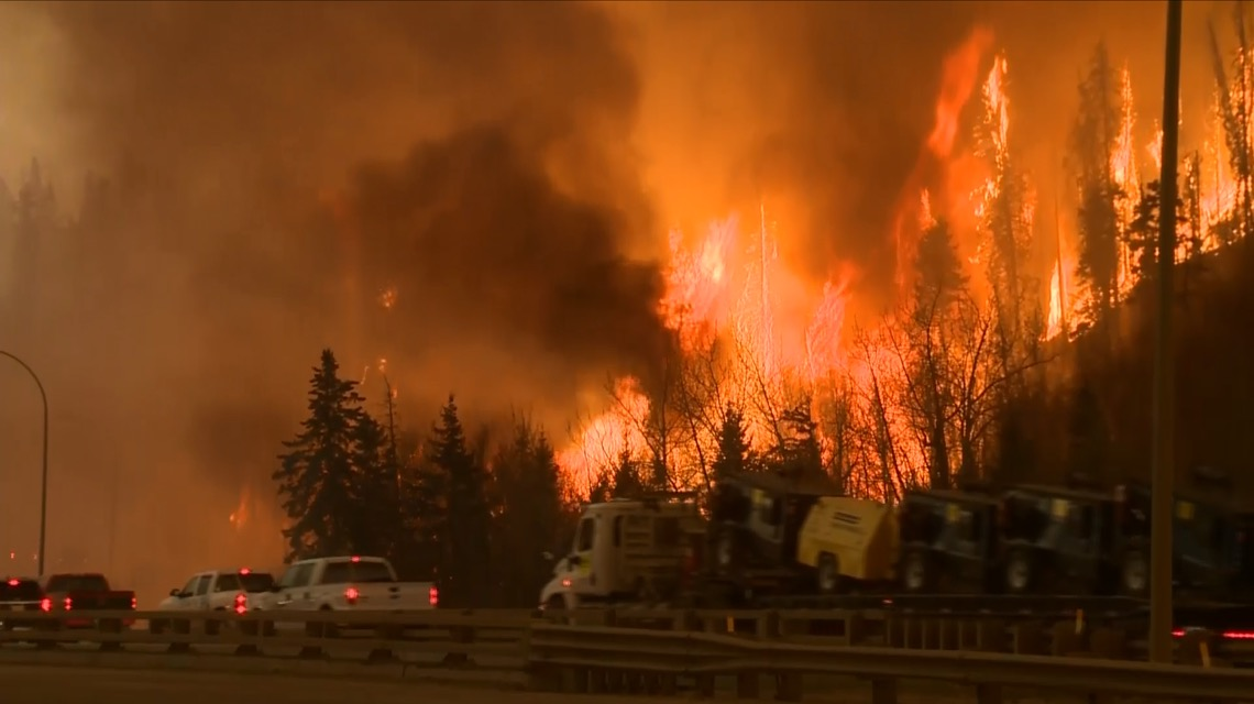 Wildfire hitting Canada's oil sands heart gets closer to major plants
